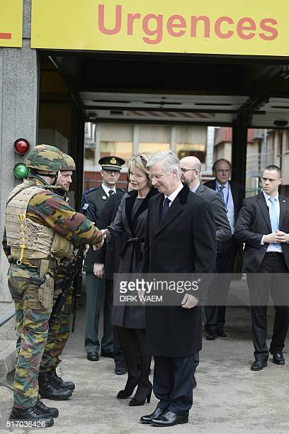King Philippe Filip of Belgium and Queen Mathilde of Belgium shake hands with a soldier after visiting victims of Brussels attacks in Erasme hospital...