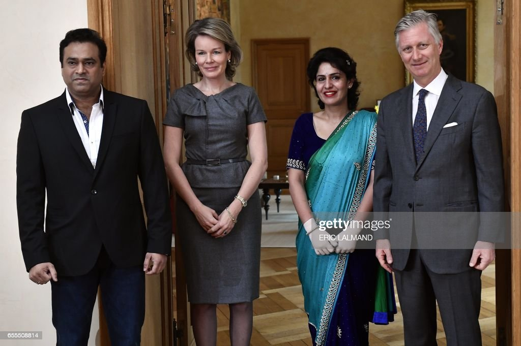 King Philippe - Filip of Belgium (R) and Queen Mathilde (2-L) pose for photographs with Indian flight attendant Nidhi Chaphekar, who was injured in the Brussels airport attack (2-R) and her husband Rupesh Chaphekar during a meeting in Brussels on March 20, 2017. / AFP PHOTO / BELGA / ERIC LALMAND / Belgium OUT