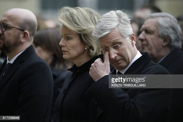 King Philippe Filip of Belgium reacts as he attends along with Queen Mathilde of Belgium and Belgian Prime Minister Charles Michel a homage ceremony...