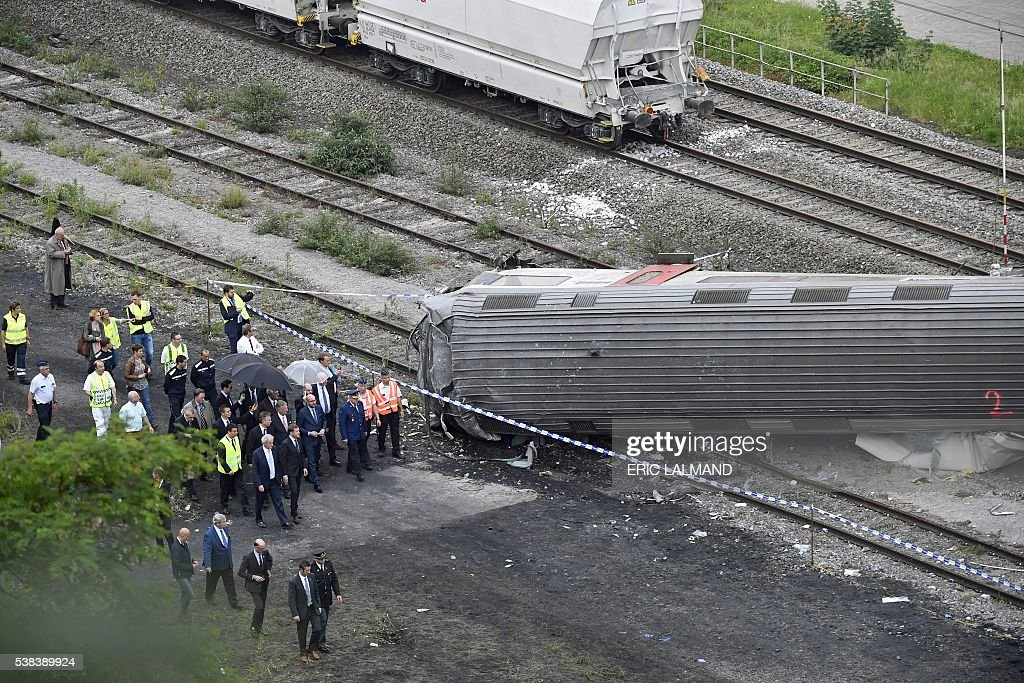 King Philippe of Belgium and Belgian Prime Minister Charles Michel visit the scene of a train collision between a freight train and a passengers...