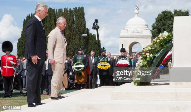 King Philippe of Belgium and Britain's Prince Charles stand after laying a wreath at the Tyne Cot Commonwealth War Graves Cemetery in Zonnebeke on...