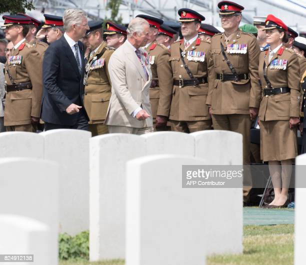 King Philippe of Belgium and Britain's Prince Charles walk past army officers during a ceremony at the Tyne Cot Commonwealth War Graves Cemetery in...
