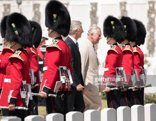 King Philippe of Belgium and Britain's Prince Charles walk past Welsh Guards at the Tyne Cot Commonwealth War Graves Cemetery in Zonnebeke on July 31...
