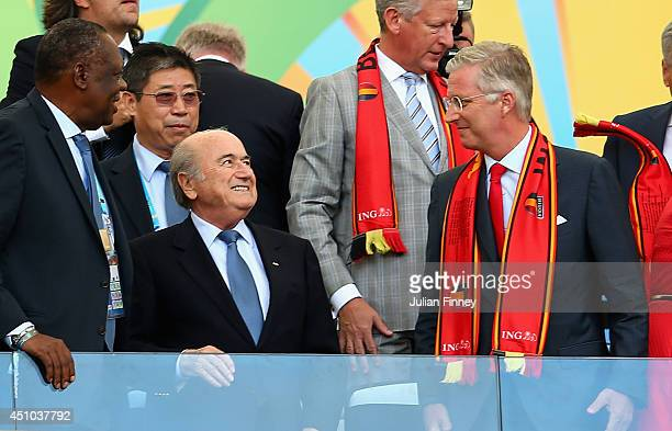 King Philippe of Belgium and FIFA president Joseph Blatter look on during the 2014 FIFA World Cup Brazil Group H match between Belgium and Russia at...