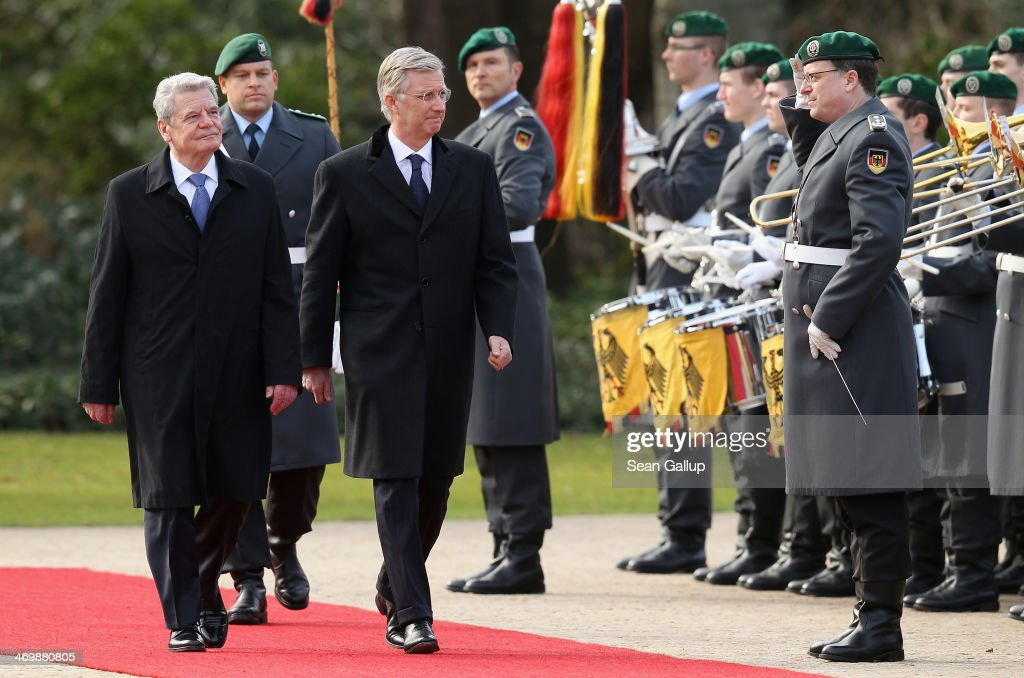 King Philippe of Belgium (C) and German President <a gi-track='captionPersonalityLinkClicked' href=/galleries/search?phrase=Joachim+Gauck&family=editorial&specificpeople=2077888 ng-click='$event.stopPropagation()'>Joachim Gauck</a> review a guard of honour upon the Belgian royal couple's arrival at Schloss Bellevue on February 17, 2014 in Berlin, Germany. King Philippe and Queen Mathile are in berlin to attend a German-Belgian conference.