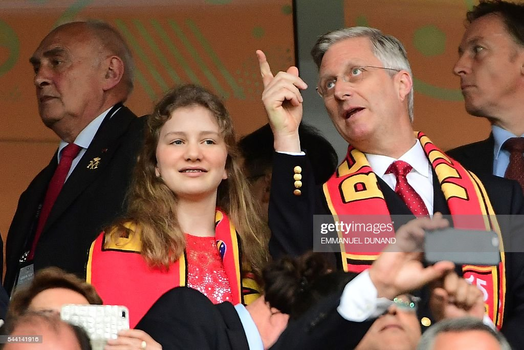 King Philippe of Belgium and his daughter Princess Elisabeth, Duchess of Brabant attend the Euro 2016 quarter-final football match between Wales and Belgium at the Pierre-Mauroy stadium in Villeneuve-d'Ascq near Lille, on July 1, 2016. / AFP / EMMANUEL