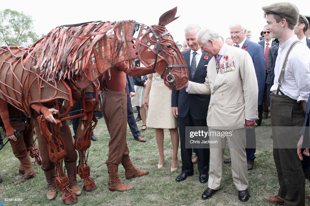 King Philippe of Belgium and Prince Charles, Prince of Wales with War Horse during their visit to Exhibition Field at the Passchendaele Memorial Park to meet families and descendants of those who fought and fell during the war on July 31, 2017 in Ypres, Belgium. The commemorations mark the centenary of Passchendaele - The Third Battle of Ypres.