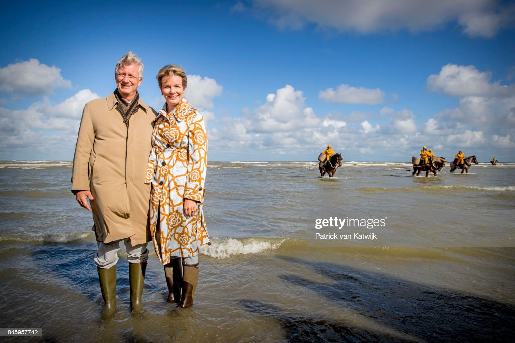 King Philippe of Belgium and Queen Mathilde of Belgium attend the shrimp fishing demonstration of the Orde van de Paardevissers (Order of the Horse Fishers) on September 12, 2017 in Oostduinkerke, Belgium.