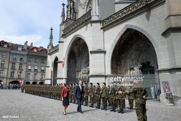King Philippe of Belgium and Swiss President Doris Leuthard review the hornour guard of Swiss army on June 22 2017 in Swiss capital Bern King...