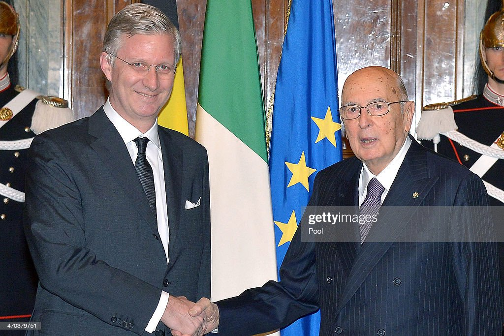 King Philippe of Belgium (L) greets Italian President <a gi-track='captionPersonalityLinkClicked' href=/galleries/search?phrase=Giorgio+Napolitano&family=editorial&specificpeople=568986 ng-click='$event.stopPropagation()'>Giorgio Napolitano</a> as he arrives at Quirinale Palace on February 19, 2014 in Rome, Italy.