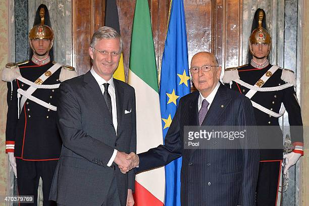King Philippe of Belgium greets Italian President Giorgio Napolitano as he arrives at Quirinale Palace on February 19 2014 in Rome Italy
