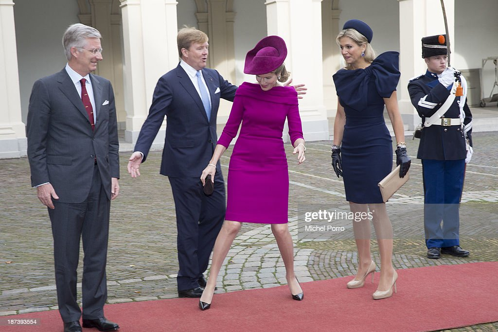 King Philippe of Belgium, <a gi-track='captionPersonalityLinkClicked' href=/galleries/search?phrase=King+Willem-Alexander&family=editorial&specificpeople=160214 ng-click='$event.stopPropagation()'>King Willem-Alexander</a> of The Netherlands, <a gi-track='captionPersonalityLinkClicked' href=/galleries/search?phrase=Queen+Mathilde+of+Belgium&family=editorial&specificpeople=239189 ng-click='$event.stopPropagation()'>Queen Mathilde of Belgium</a> and Queen Maxima of The Netherlands arrive at the Noordeinde Palace during an official visit to The Netherlands on November 8, 2013 in The Hague, Netherlands.