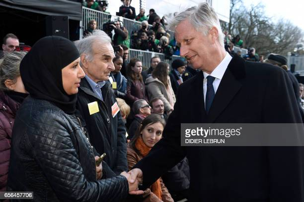 King Philippe of Belgium meets people during the inauguration of a steel memorial by Belgian sculptor JeanHenri Compere at the heart of the European...