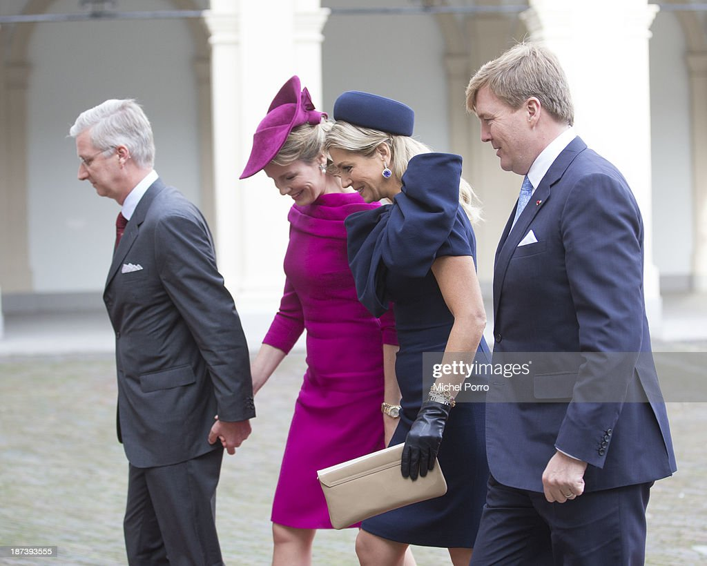 King Philippe of Belgium, <a gi-track='captionPersonalityLinkClicked' href=/galleries/search?phrase=Queen+Mathilde+of+Belgium&family=editorial&specificpeople=239189 ng-click='$event.stopPropagation()'>Queen Mathilde of Belgium</a>, Queen Maxima of The Netherlands and <a gi-track='captionPersonalityLinkClicked' href=/galleries/search?phrase=King+Willem-Alexander&family=editorial&specificpeople=160214 ng-click='$event.stopPropagation()'>King Willem-Alexander</a> of The Netherlands arrive at the Noordeinde Palace during an official visit to The Netherlands on November 8, 2013 in The Hague, Netherlands.