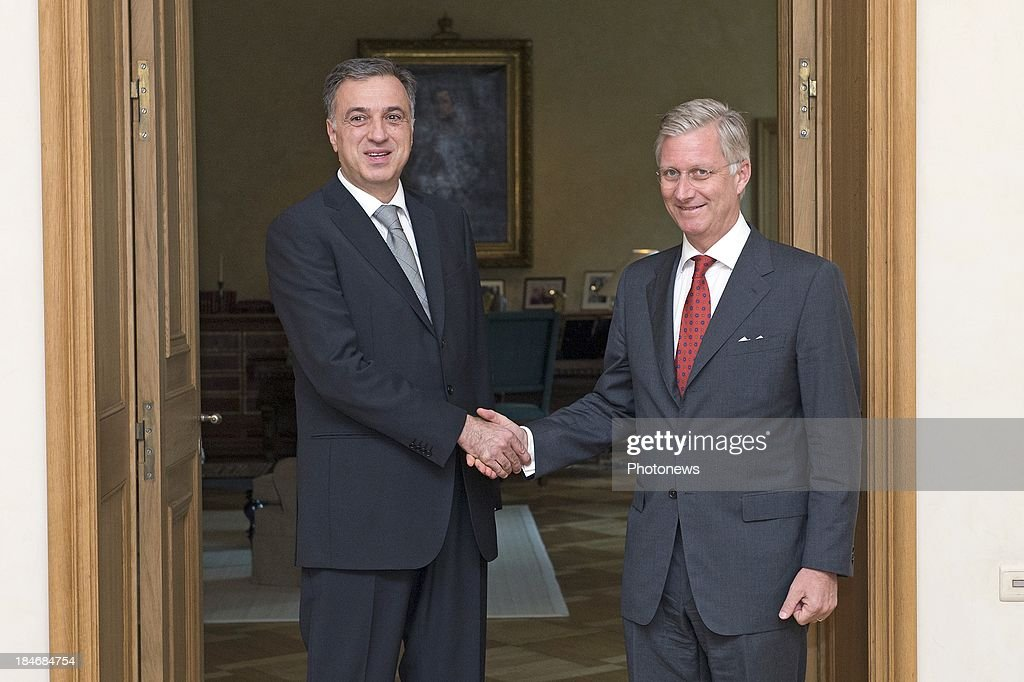 King <a gi-track='captionPersonalityLinkClicked' href=/galleries/search?phrase=Philippe+of+Belgium&family=editorial&specificpeople=160209 ng-click='$event.stopPropagation()'>Philippe of Belgium</a> (R) shakes hands with <a gi-track='captionPersonalityLinkClicked' href=/galleries/search?phrase=Filip+Vujanovic&family=editorial&specificpeople=596296 ng-click='$event.stopPropagation()'>Filip Vujanovic</a>, President of Montenegro on October 15, 2013 in Brussels, Belgium.