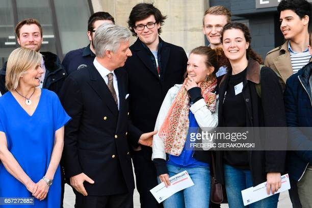 King Philippe of Belgium speaks with students during a visit at the VUB University on March 24 2017 in Liege / AFP PHOTO / BELGA / FREDERIC...