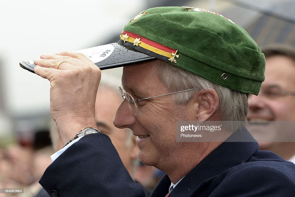 King <a gi-track='captionPersonalityLinkClicked' href=/galleries/search?phrase=Philippe+of+Belgium&family=editorial&specificpeople=160209 ng-click='$event.stopPropagation()'>Philippe of Belgium</a> tries on a cap during his visit to the city of Liege with Queen Mathilde (not pictured) as part of the royal couple's tour of the provinces on October 11, 2013 in Belgium.