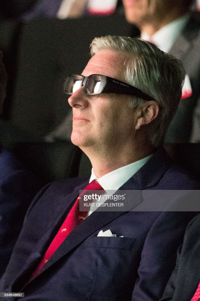 King Philippe of Belgium wears glasses during a visit to the hardware and software manufacturer Barco group, May 27, 2016, in Kortrijk. / AFP / Belga / KURT DESPLENTER / Belgium OUT