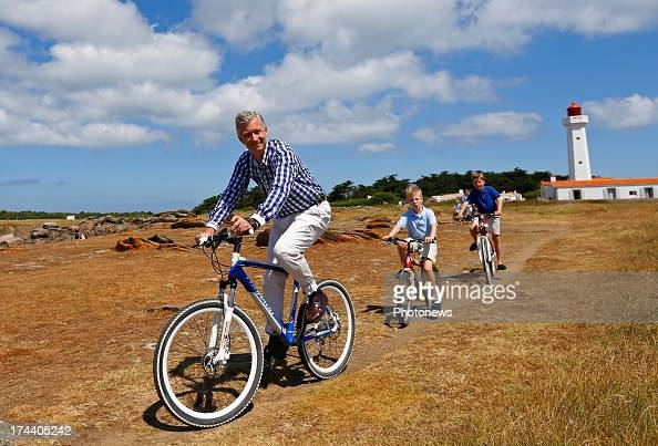 King Philippe Prince Emmanuel and Prince Gabriel of Belgium riding their bikes during their holiday on l'Ile d'Yeu on July 24 2013 in Yeu France