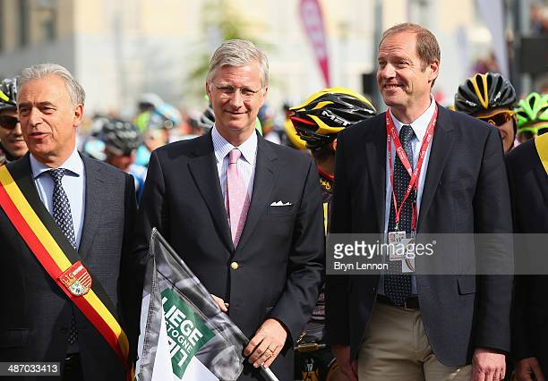 King Phillipe of Belgium and the Tour de France Race Director Christian Prudhomme are seen before giving the start of the 100th edition of the...