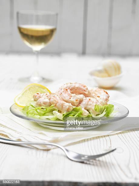 King prawn cocktail with paprika, slice lemon and lettuce salad