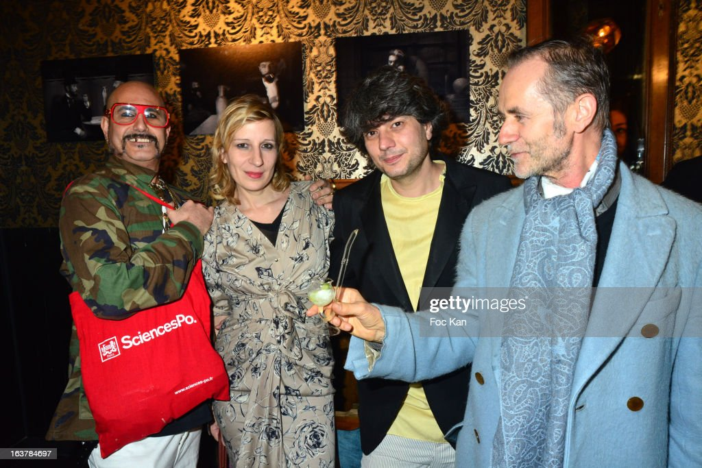 DJ King Sabbah (Claude Sabbah), Sarah Steinitz, Gregori Erman from June Sex band and Vincent de Trecaen (holding a pipe of absinthe ) attend 'La Dance des Coincidences' Party At The Favella Chic on March15, 2013 in Paris, France.