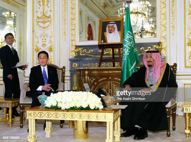 King Salman bin Abdulaziz Al Saud of Saudi Arabia and Japanese Foreign Minister Fumio Kishida talk during their meeting at the Akasaka State Guest...
