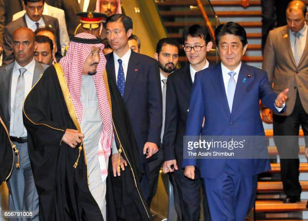 King Salman bin Abdulaziz Al Saud of Saudi Arabia is escorted by Japanese Prime Minister Shinzo Abe prior to the welcome ceremony at Abe's official...
