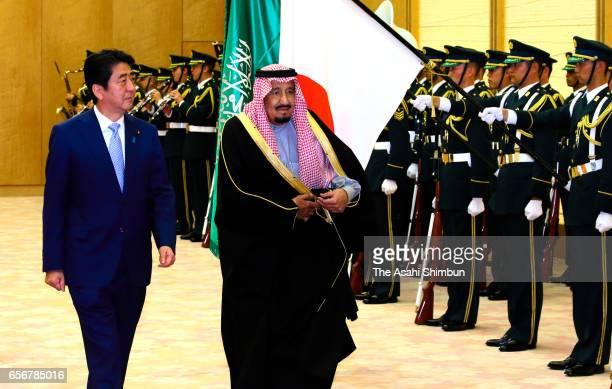 King Salman bin Abdulaziz Al Saud of Saudi Arabia reviews the honour guard with Japanese Prime Minister Shinzo Abe during the welcome ceremony at...