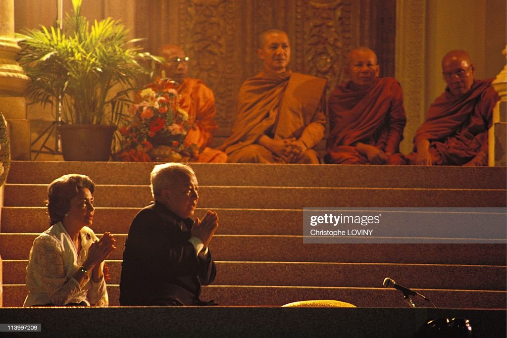King Sihanouk and Queen Monineath at a Buddhist ceremony In Phnom Penh, Cambodia In 1997-At the royal palace.