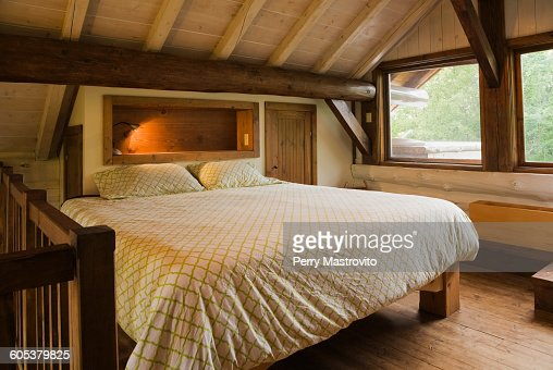 King Size Bed On Wooden Frame In Master Bedroom On The Mezzanine