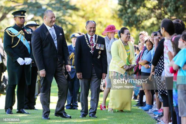 King Tupou VI GovernorGeneral Sir Jerry Mateparae and Queen Nanasipau'u meet school children during a State Welcome at Government House on February...