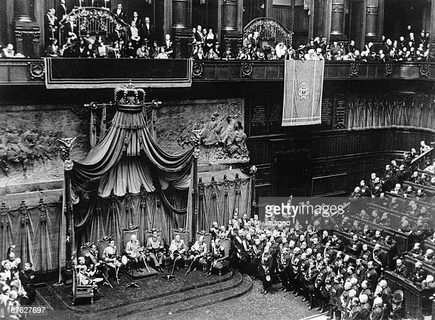 King Victor Emmanuel reads his speech from the throne at the opening of the Italian Parliament In the picture on the right standing Prime Minister...