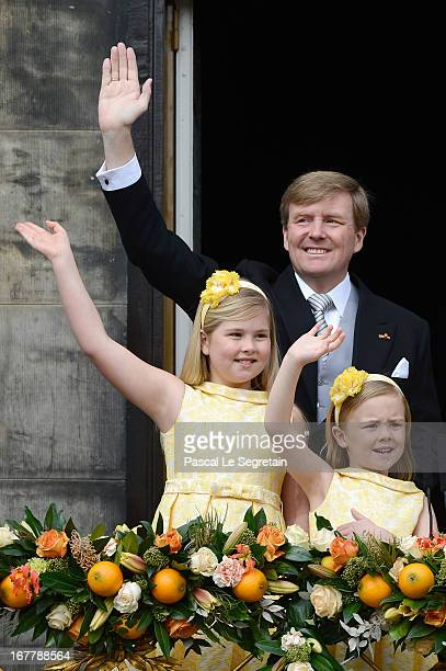 King Willem Alexander and his daughters Princess Catharina Amalia and Princess Ariane of the Netherlands appear on the balcony of the Royal Palace to...