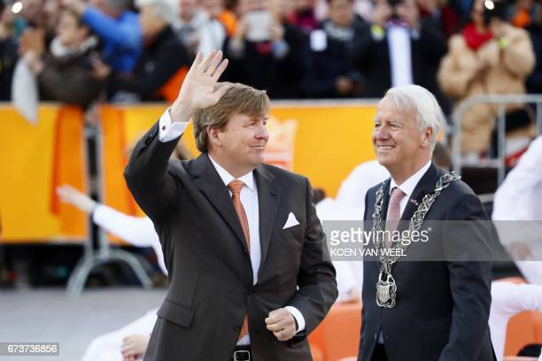King Willem Alexander and other members of the Dutch royal family arrive in Tilburg the Netherlands on April 27 2017 during the King's day marking...