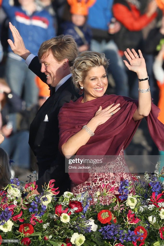 King Willem Alexander and Queen Maxima are seen aboard the King's boat for the water pageant to celebrate the inauguration of King Willem of the Netherlands after the abdication of his mother Queen Beatrix of the Netherlands on April 30, 2013 in Amsterdam, Netherlands.