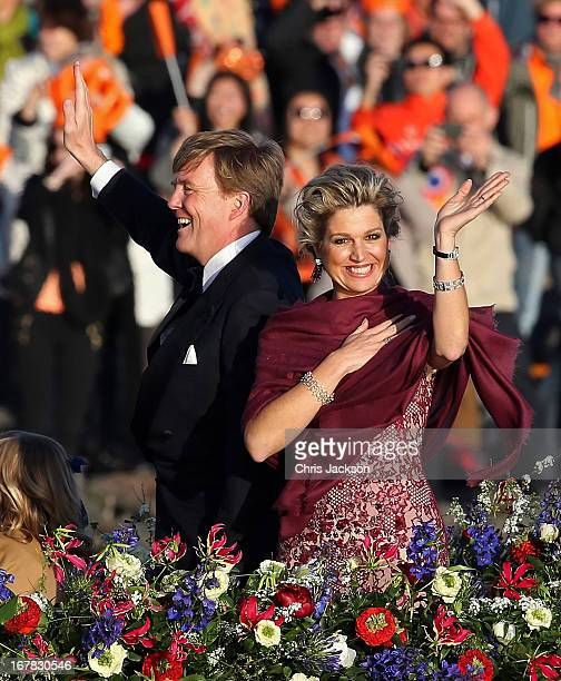 King Willem Alexander and Queen Maxima are seen aboard the Kings boat for the water pageant to celebrate the inauguration of King Willem of the...