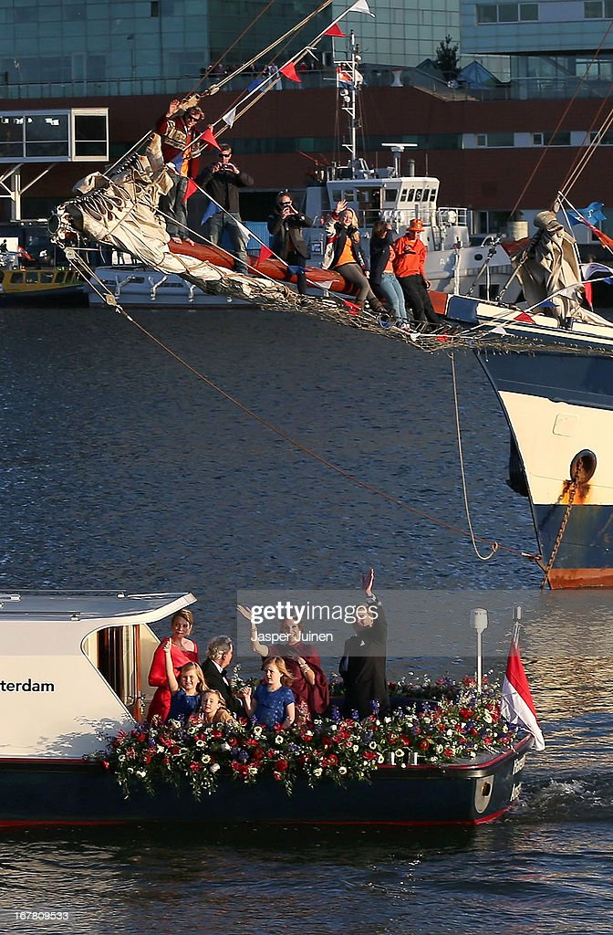 King Willem Alexander and Queen Maxima of the Netherlands are seen aboard the King's boat for the water pageant to celebrate the inauguration of King Willem of the Netherlands after the abdication of his mother Queen Beatrix of the Netherlands on April 30, 2013 in Amsterdam, Netherlands.