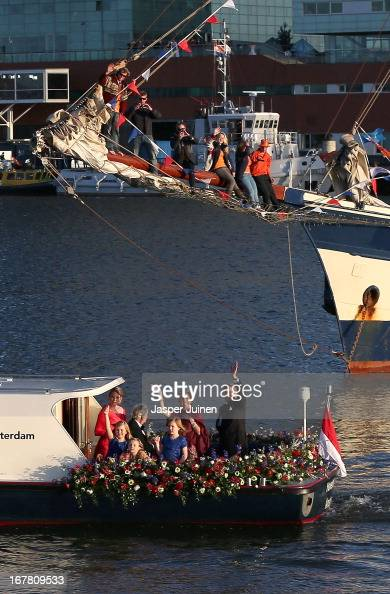King Willem Alexander and Queen Maxima of the Netherlands are seen aboard the King's boat for the water pageant to celebrate the inauguration of King...