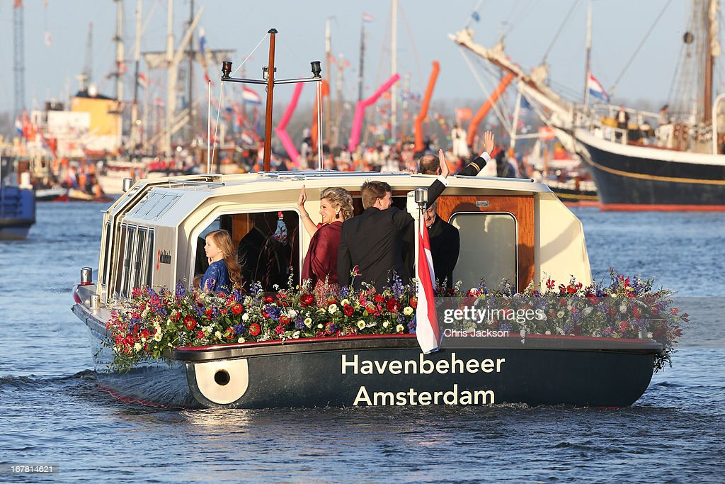 King Willem Alexander and Queen Maxima of The Netherlands are seen aboard the King's boat for the water pageant to celebrate the inauguration of King Willem Alexander of the Netherlands after the abdication of his mother Queen Beatrix of the Netherlands on April 30, 2013 in Amsterdam, Netherlands.