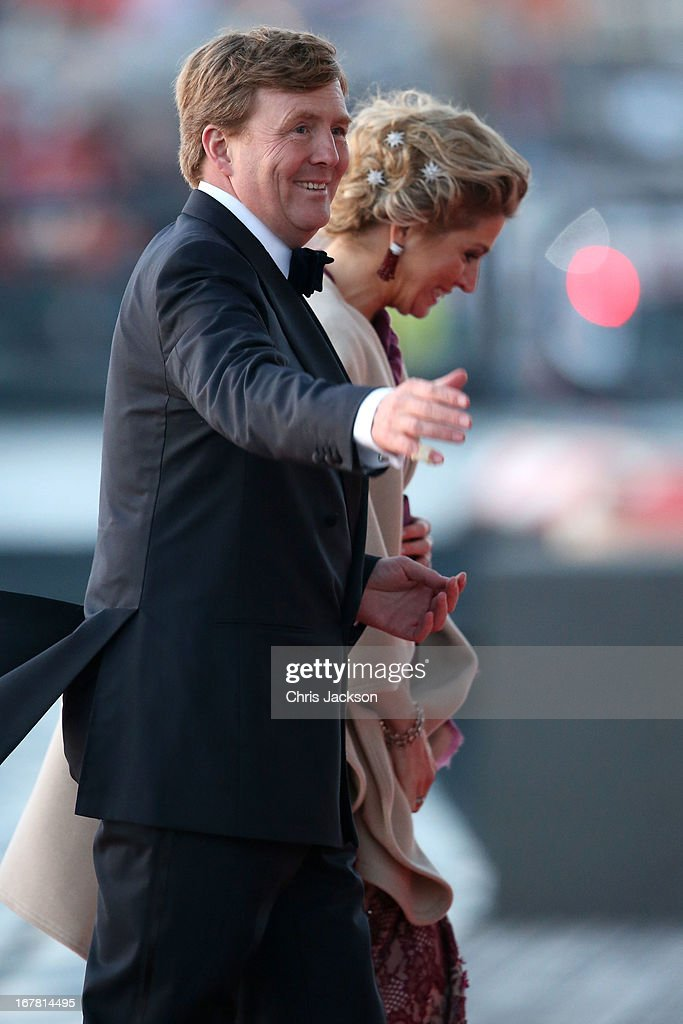King Willem Alexander and Queen Maxima of The Netherlands arrive at the Muziekbouw following the water pageant after the abdication of Queen Beatrix of the Netherlands and the Inauguration of King Willem Alexander of the Netherlands on April 30, 2013 in Amsterdam, Netherlands.