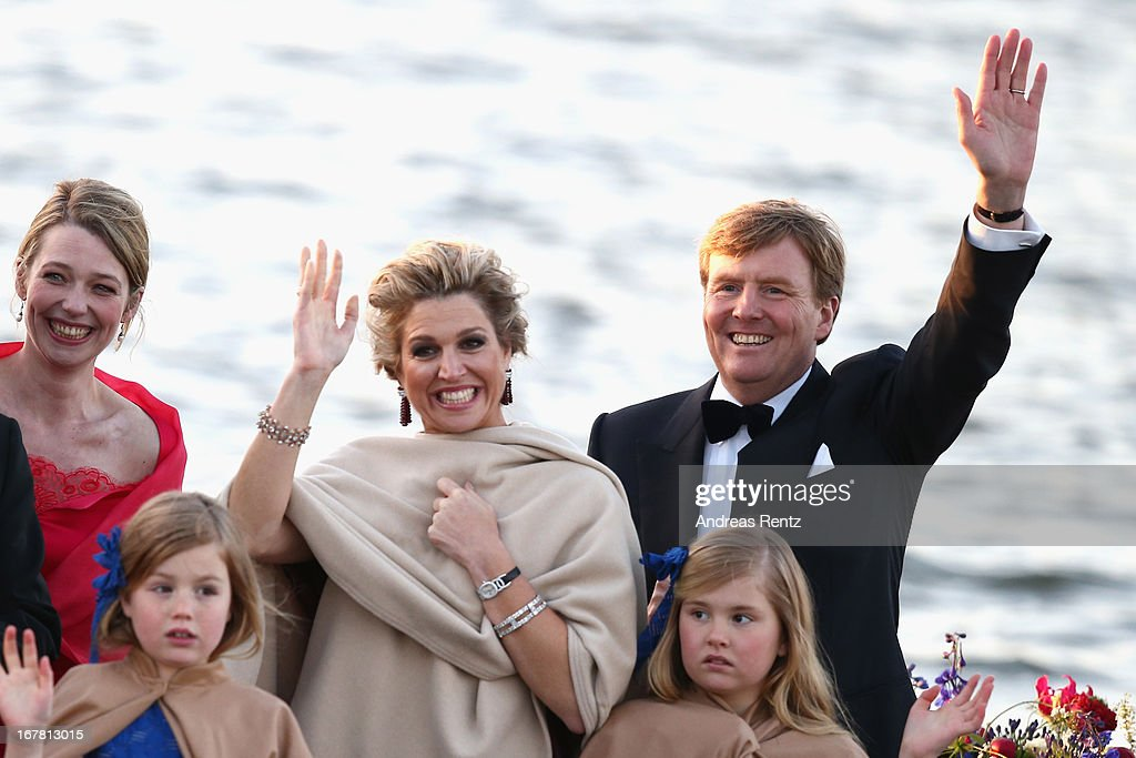 King Willem Alexander (R) and Queen Maxima (C) of The Netherlands with daughters Princess Alexia and Princess Catharina-Amalia are seen aboard the King's boat for the water pageant to celebrate the inauguration of King Willem Alexander of the Netherlands after the abdication of his mother Queen Beatrix of the Netherlands on April 30, 2013 in Amsterdam, Netherlands.