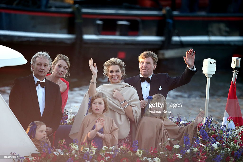 King Willem Alexander (L) and Queen Maxima (R) of The Netherlands with daughters Princess Alexia and Princess Catharina-Amalia are seen aboard the King's boat for the water pageant to celebrate the inauguration of King Willem Alexander of the Netherlands after the abdication of his mother Queen Beatrix of the Netherlands on April 30, 2013 in Amsterdam, Netherlands.