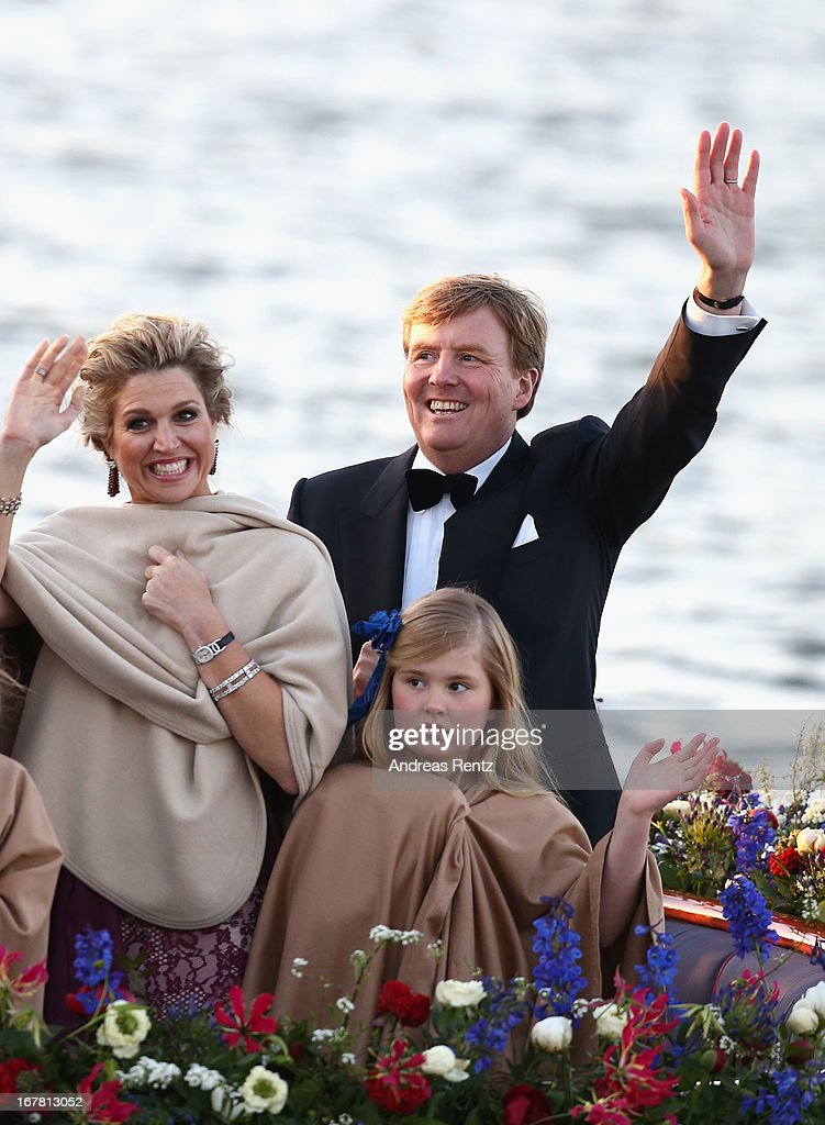 King Willem Alexander and Queen Maxima of The Netherlands with daughter Princess Catharina-Amalia are seen aboard the King's boat for the water pageant to celebrate the inauguration of King Willem Alexander of the Netherlands after the abdication of his mother Queen Beatrix of the Netherlands on April 30, 2013 in Amsterdam, Netherlands.