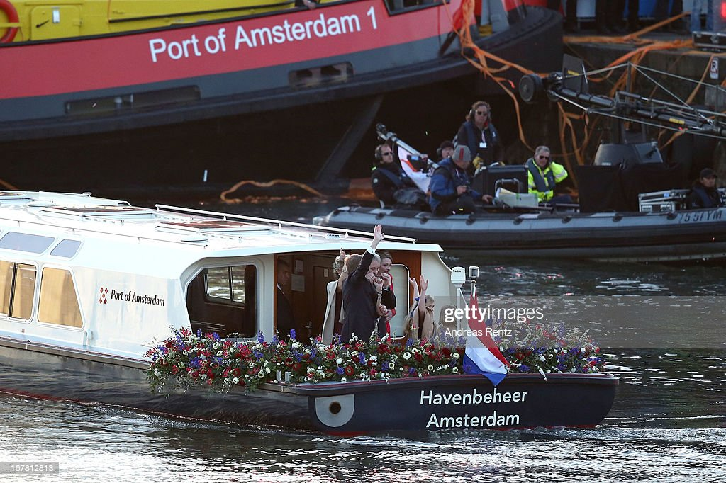 King Willem Alexander (R) and Queen Maxima (C) of The Netherlands with daughters Princess Ariane, Princess Alexia and Princess Catharina-Amalia are seen aboard the King's boat for the water pageant to celebrate the inauguration of King Willem Alexander of the Netherlands after the abdication of his mother Queen Beatrix of the Netherlands on April 30, 2013 in Amsterdam, Netherlands.