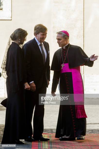 King Willem Alexander and the Queen Maxima of the Netherlands speak with Archbishop Georg Gaenswein prefect of the Papal Household as they arrive at...