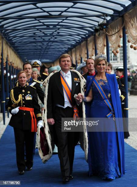 King Willem Alexander of the Netherlands and HM Queen Maxima of the Netherlands leave following the inauguration ceremony at New Church on April 30...