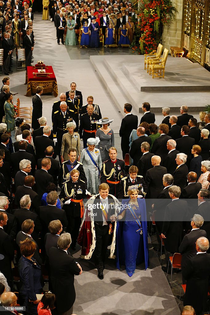 King Willem Alexander of the Netherlands and Queen Maxima of the Netherlands (R) leave after attending the inauguration of <a gi-track='captionPersonalityLinkClicked' href=/galleries/search?phrase=King+Willem-Alexander&family=editorial&specificpeople=160214 ng-click='$event.stopPropagation()'>King Willem-Alexander</a> in front of a joint session of the two houses of the States General at Nieuwe Kerk on April 30, 2013 in Amsterdam, Netherlands.