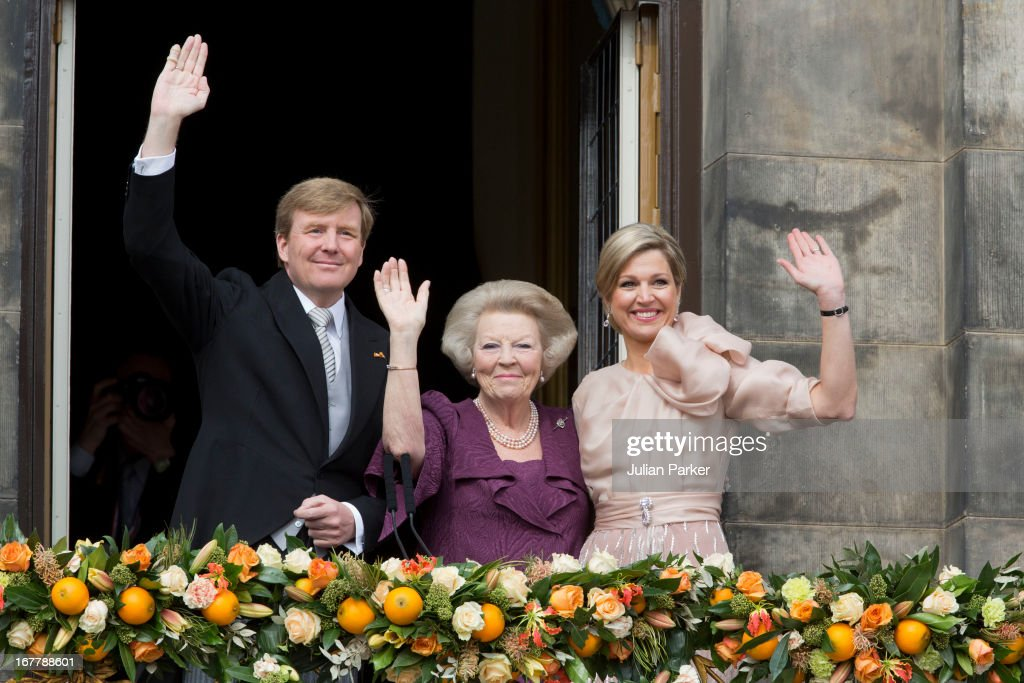 HM King Willem Alexander of the Netherlands, HRH Princess Beatrix of the Netherlands and and HM Queen Maxima of Holland of the Netherlands appear on the Balcony of the Royal Palace in Amsterdam to greet the public after her abdication and ahead of the inauguration of HM King Willem Alexander of the Netherlands on April 30, 2013 in Amsterdam, Netherlands.
