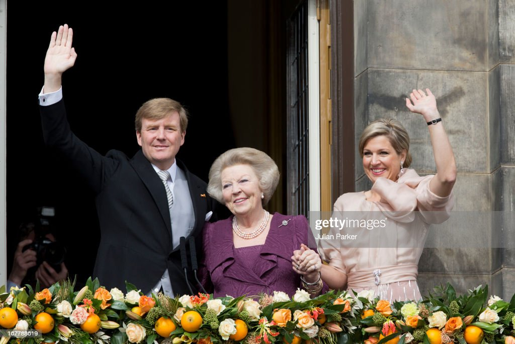 HM King Willem Alexander of the Netherlands, HRH Princess <a gi-track='captionPersonalityLinkClicked' href=/galleries/search?phrase=Beatrix+of+the+Netherlands&family=editorial&specificpeople=92396 ng-click='$event.stopPropagation()'>Beatrix of the Netherlands</a> and and HM Queen Maxima of Holland of the Netherlands appear on the Balcony of the Royal Palace in Amsterdam to greet the public after her abdication and ahead of the inauguration of HM King Willem Alexander of the Netherlands on April 30, 2013 in Amsterdam, Netherlands.